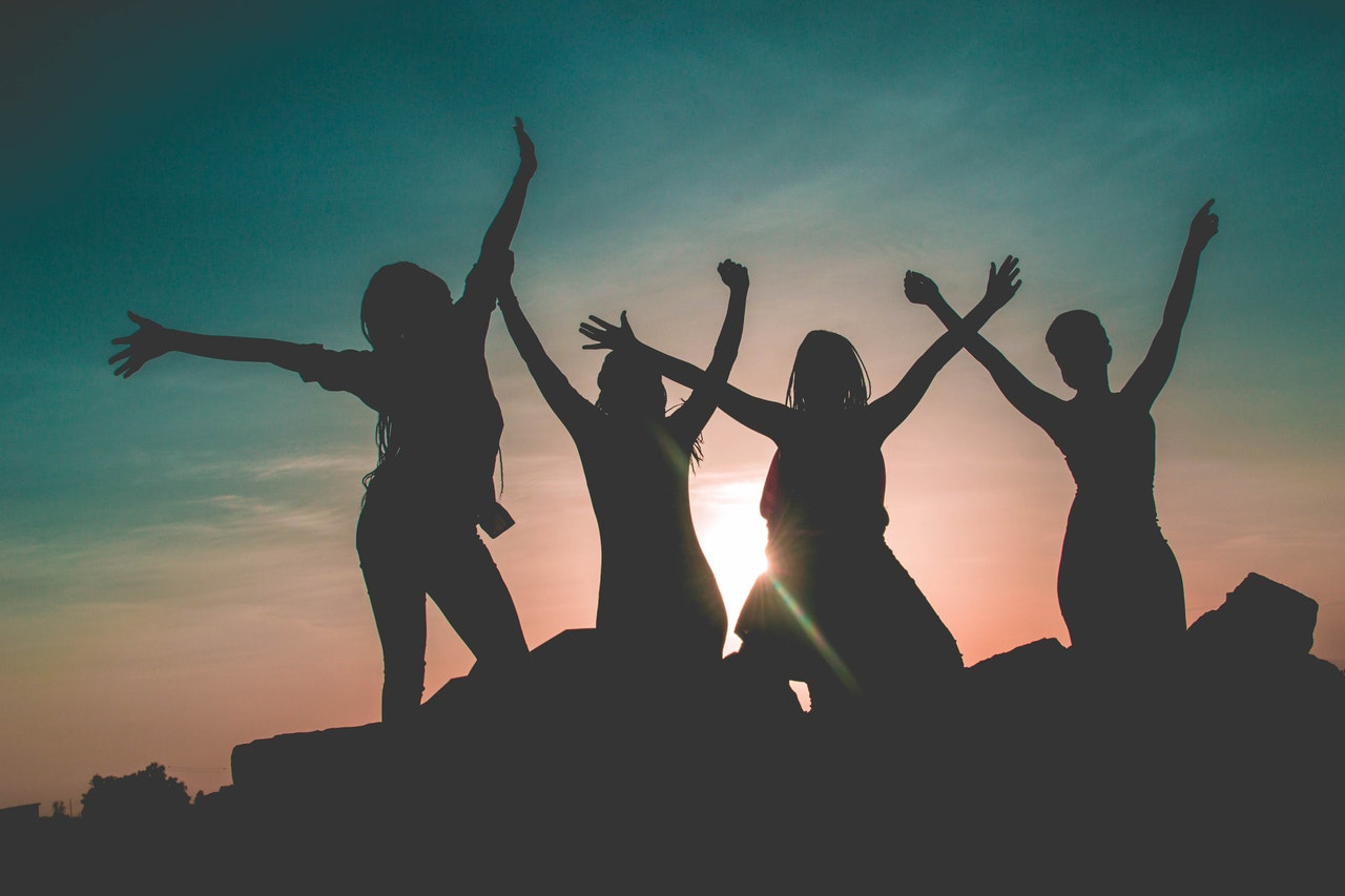 Picture of Women with Arms up in Silhouette