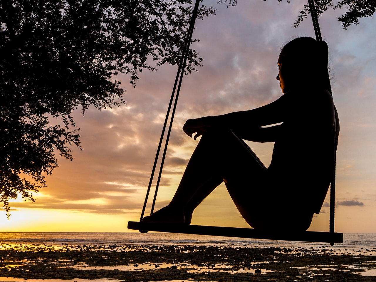Picture of Woman on Swing at Sunset